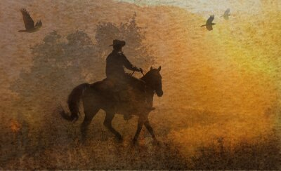 Canvas print A dramatic design of a cowboy and his horse riding in a meadow into the sunset with crows flying above.  A mixed media piece of artwork in photography and watercolor.