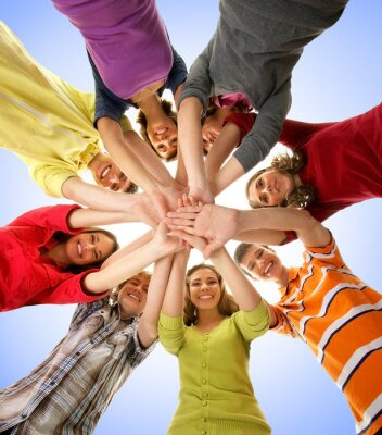 Canvas print A group of happy teenagers holding hands together