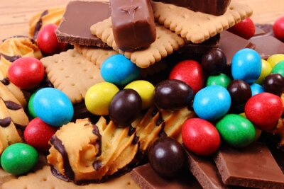 Canvas print A lot of sweets on wooden surface, unhealthy food
