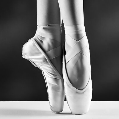 Canvas print A photo of ballerina's pointes on black background