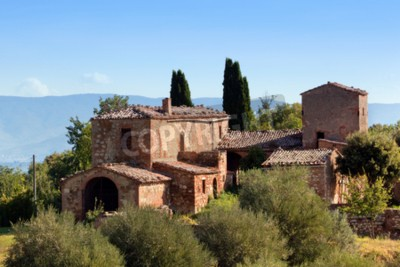 Canvas print A residence in Tuscany, Italy. Typical for the region tuscan farm house, hills, cypress trees. Italy