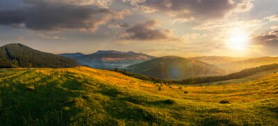 Canvas print agricultural field in mountains at sunset