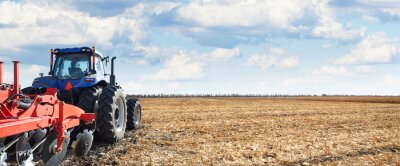 Canvas print Agricultural machinery works in the field