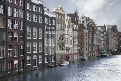 Canvas print Amsterdam canals and typical houses on a blue sunny day