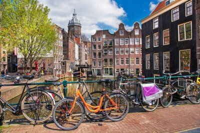Canvas print Amsterdam city with bikes on the bridge in  Holland