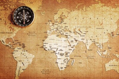 Canvas print An old brass compass on a Treasure map background