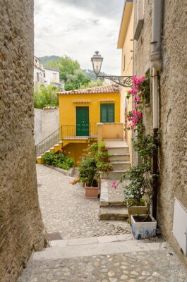 Canvas print Ancient street in old town of a southern Italy village
