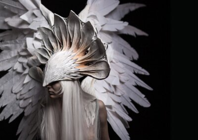 Canvas print Angel, costume, concept, cinematic, a portrait of a young girl and a white wig , which carries a large white mask and a large white wings. Dramatic