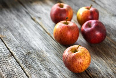 Canvas print Apples on wooden background