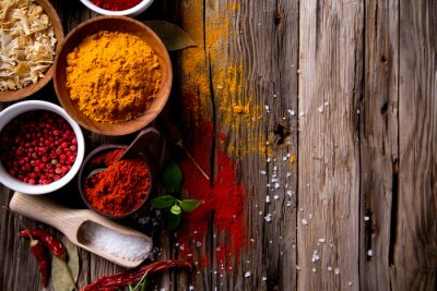 Canvas print Assorted spices on wooden background