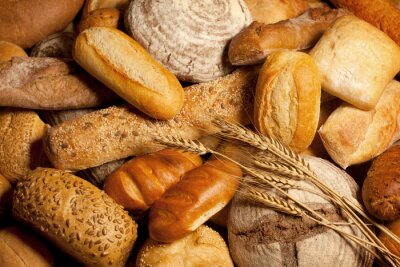 Canvas print assortment of baked bread with wheat