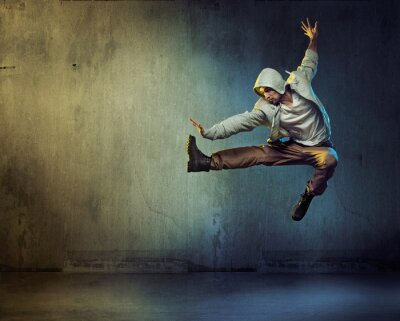 Canvas print Athletic dancer in a jumping pose