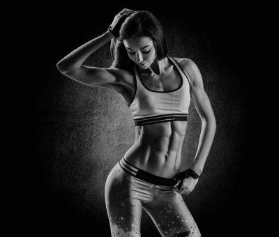 Canvas print attractive fitness woman, trained female body, lifestyle portrai