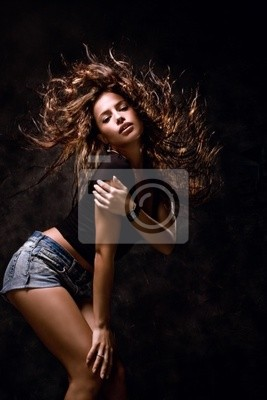 attractive young woman dancing, hair flying