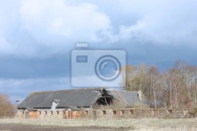Autumn rural landscape with abandoned farmhouse