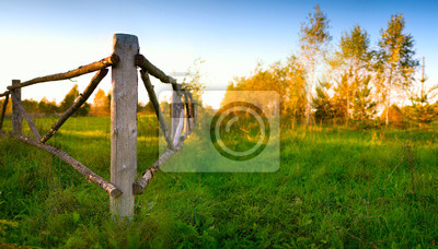 Autumn rural landscape with fence and footpath
