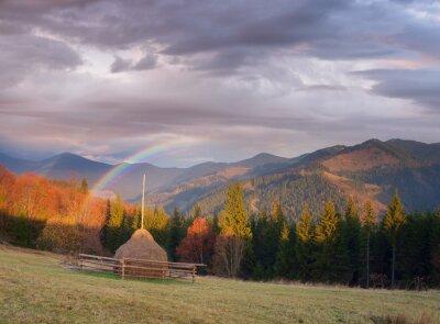 Autumn rural landscape with haystacks