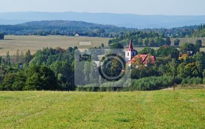 Autumn rural landscape with village church