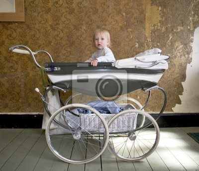 baby in a  1950's Silver Cross perambulater