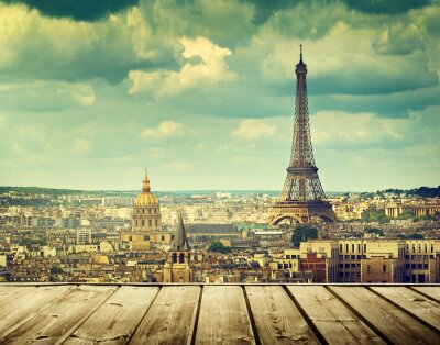 Canvas print background with wooden deck table and Eiffel tower in Paris