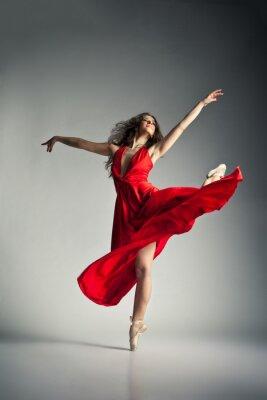 Canvas print Ballet dancer wearing red dress over grey