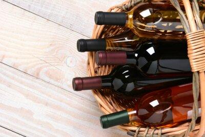 Canvas print Basket of Wine Bottles