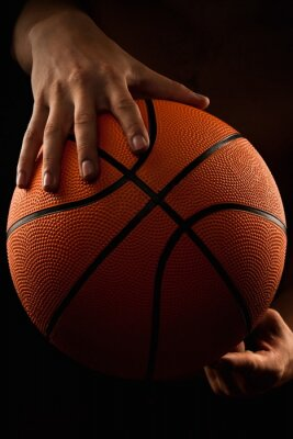Canvas print Basketball ball in male hands