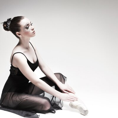 Canvas print Beautiful ballet-dancer, modern style dancer posing on studio