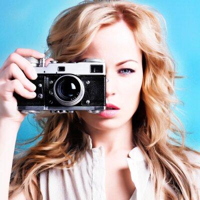 Canvas print beautiful blond photographer woman holding retro camera