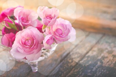Canvas print Beautiful bouquet of rose flowers on old weathered wood