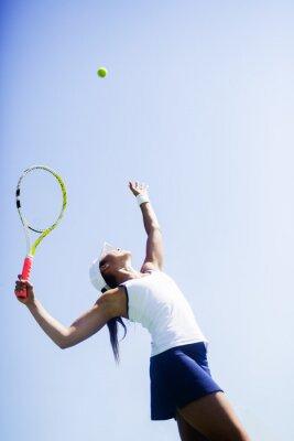 Canvas print Beautiful female tennis player serving