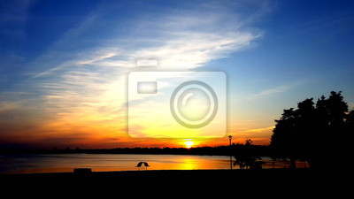Beautiful landscape with sunset on river. Oil paint landscape in post production.