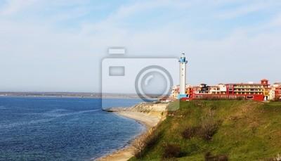 Beautiful lighthouse on sea coast