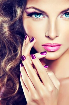 Canvas print beautiful model with curly hair and purple manicure