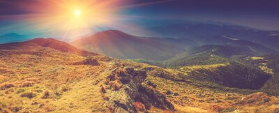 Canvas print Beautiful panoramic landscape in the mountains at sunshine.