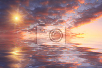 Beautiful sunset over sea with reflection in water