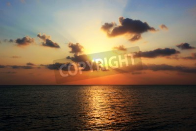 Beautiful sunset over sea with reflection in water. Koh Phangan