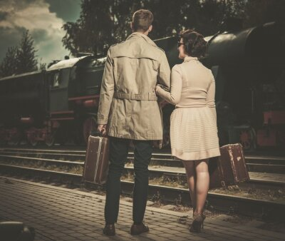 Canvas print Beautiful vintage style couple with suitcases