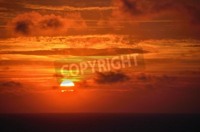 beautiful warm red sunset at sea with horziont
