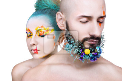 Beautiful woman and man with colorful makeup on white background, flowers on man beard