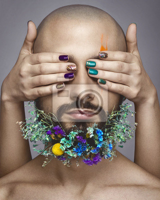 Beautiful woman hands with nail art and man with colorful makeup on white background, flowers on man beard