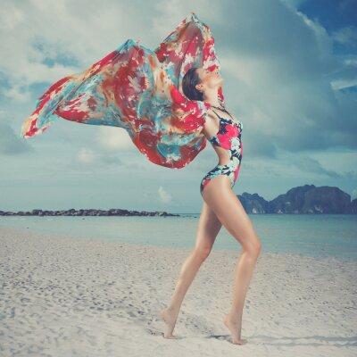 Canvas print Beautiful woman on the beach