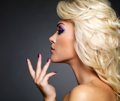 Canvas print Beautiful woman with beauty purple manicure and makeup of eyes.