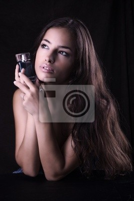 beautiful woman with bottle of perfume