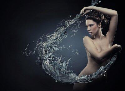 Beautiful women over water splash