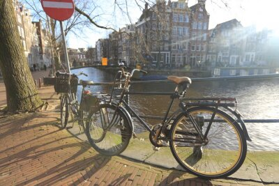 Canvas print Bicycles lining a bridge over the canals of Amsterdam, Netherlands