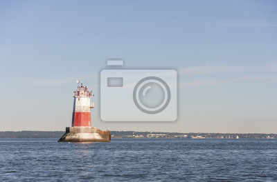 Big marine sign or lighthouse in sea
