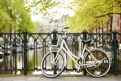 Canvas print bike on amsterdam street in city