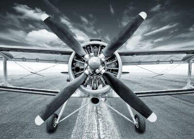 Canvas print biplane on a runway