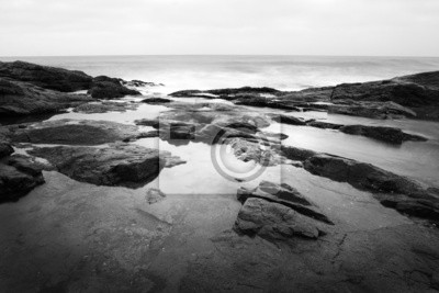 Canvas print Black and white image of a dramatic ocean scene
